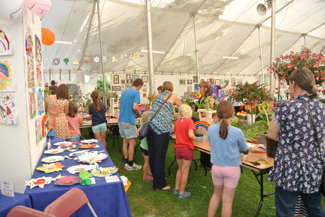 Children bringing in their exhibits to the Competition Marquee