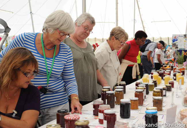 Ladies looking over the jams and preserves categories of the competition marquee